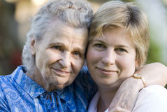 Women. Elderly woman with her daughter Stock Photos