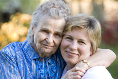 Women. Elderly woman with her daughter Royalty Free Stock Image