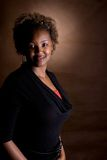 Women. Portrait of a beautiful african american in brown background Royalty Free Stock Images