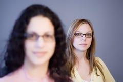 Women. Two women in glasses stock photos