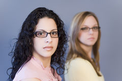 Women. Two women in glasses. Woman in background out of focus Stock Images