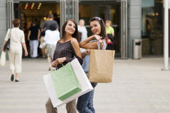 Women. Two girls just outside of commercial center with her purchases in bags Stock Images
