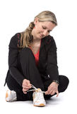 Women. Young women with sportswear sitt on the floor. White background Stock Images