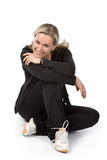 Women. Young women with sportswear sitt on the floor. White background Royalty Free Stock Photography