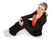 Women. Young women with sportswear sitt on the floor. White background Stock Photos