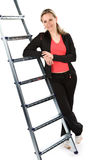 Women. Young women with sportswear on ladder. White background Royalty Free Stock Images
