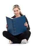 Women. Young women with book sitt on the floor. White background Stock Photos