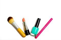 Women& x27 ; accessoires et produits de beauté de s sur un fond blanc Photographie stock libre de droits
