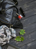 Women accessories black leather handbag, scarf, watch, nail Polish and tablet computer Stock Photography