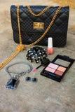 Women accessories: eyeshadow, nail polish, clip hair, handbag Stock Image