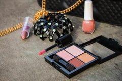 Women accessories: eyeshadow, nail polish, clip hair, handbag Stock Photo