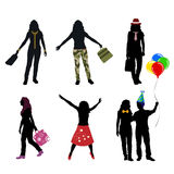 Women in aciton silhouette Stock Images