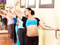 Women in aerobics class. Women group in aerobics class do exercises royalty free stock images