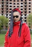 Women with afrobraids. Women Hairstyle with hair extensions braided in thin plaits and afrobraids Stock Photo