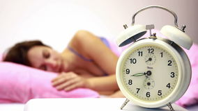 Women and Alarm Clock Royalty Free Stock Images