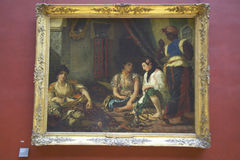 Women of Algiers in Their Apartment by Eugene Delacroix, 1834 at the Louvre Museum, Paris, France, Oil on canvas Royalty Free Stock Images