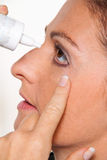 Women with allergies. And eye drops. Hay fever. Instillation of the eye royalty free stock photos
