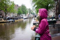 Women in Amsterdam raining Stock Photo