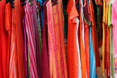 Women apparel. Colorful Indian apparel for young women arranged in a row Stock Photo