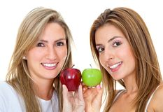Women with apples isolated Royalty Free Stock Images