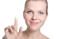 Women applying cream to her nose Stock Photography