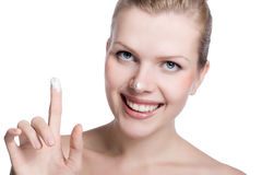 Women applying cream to her nose Royalty Free Stock Image