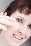 Women applying eye skin cream Stock Photo