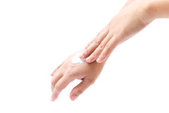 Women applying hand cream to hands Royalty Free Stock Images