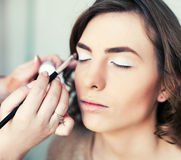 Women applying makeup Royalty Free Stock Photos