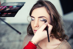 Women applying makeup stock photo