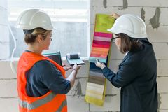 Women architect and designer on a design object with samples of fabrics.  royalty free stock images