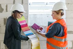 Women architect and designer on design object with samples of fabrics.  royalty free stock photos