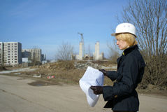 Women architect with hard hat at construction site Royalty Free Stock Photography