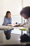 Women Architects Review Plans And Housing Project In Office Stock Images