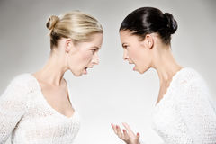 Women arguing. Two young caucasian women arguing, studio shot royalty free stock photos