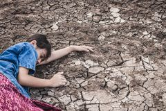 The women on the arid soil in hot weather lacked drinking. The woman on the arid soil in hot weather lacked drinking water Stock Images