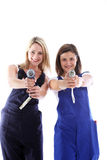 Women artisans taking aim. Humorous image of two attractive women artisans having fun taking aim at the camera with their handheld power tools Stock Photo
