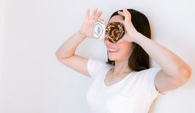 Women asia wearing white shirts holding donuts. To eat royalty free stock photos