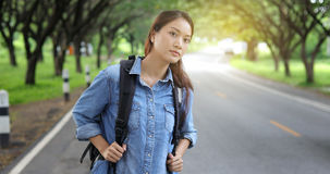 Women asian with bright backpack of the tourist traveler on natu. Re Stock Photo