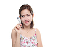 Women asian happy smiling with eyelash curler isolated on white background Stock Image