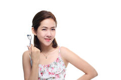 Women asian happy smiling with eyelash curler isolated on white background Stock Photos
