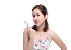 Women asian happy smiling with eyelash curler isolated on white background Royalty Free Stock Photos