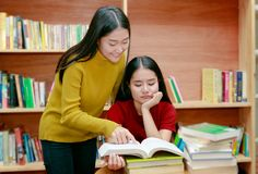 Women Asian students reading books In university library Royalty Free Stock Photo