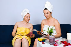Women At Spa In Waiting Room Read Magazines Royalty Free Stock Photography