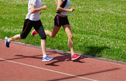 Women athletes running Royalty Free Stock Photo