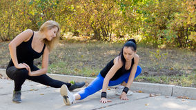 Women athletes training outdoors Stock Photography