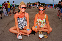 Women from the audience have a beer in the floor during a concert at FIB Festival Stock Photo