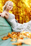 Women with autumn leafs Royalty Free Stock Photography