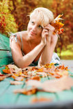 Women with autumn leafs. In the park Royalty Free Stock Photos