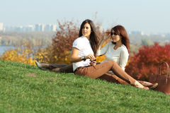 Women with autumn maple leaves in park Stock Images